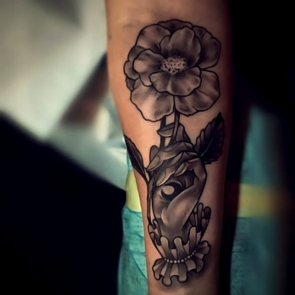 Zakk: Black & Grey Hand Holding Flower